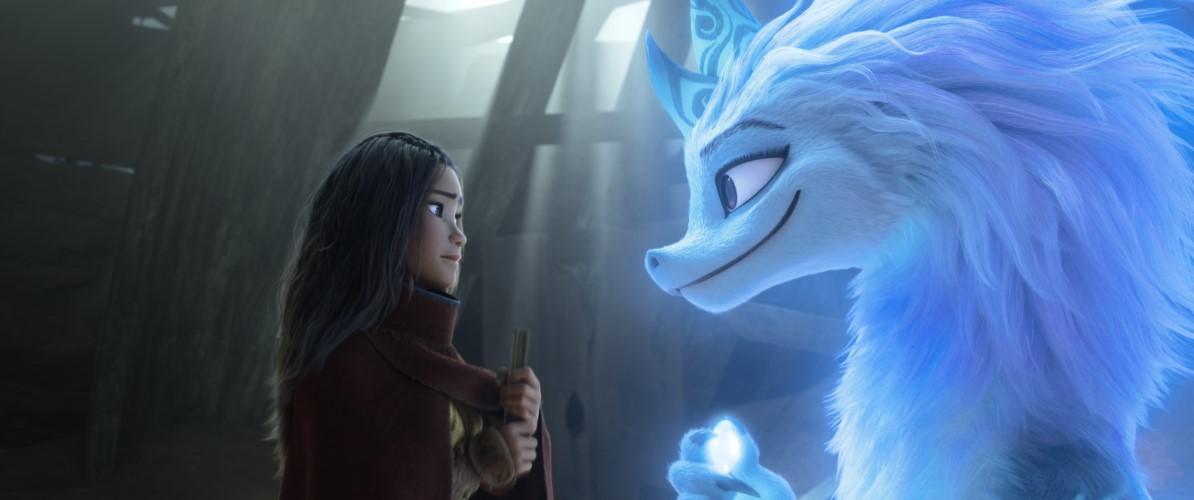 A girl facing a blue furry dragon